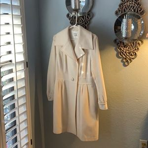 Winter white wool coat large lapels.